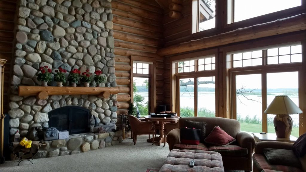 Saugatuck Log Home Uses Vista Home Window Film to Improve Comfort - Home Window Tinting in Traverse City, Grand Rapids, Cadillac, Petoskey, Roscommon, Ludington, Michigan and their surrounding areas. 2