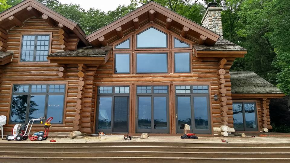 Saugatuck Log Home Uses Vista Home Window Film to Improve Comfort - Home Window Tinting in Traverse City, Grand Rapids, Cadillac, Petoskey, Roscommon, Ludington, Michigan and their surrounding areas.