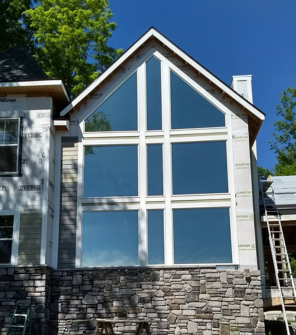 Vista V18 Celeste home window tinting in Alger, Michigan. Exterior view.